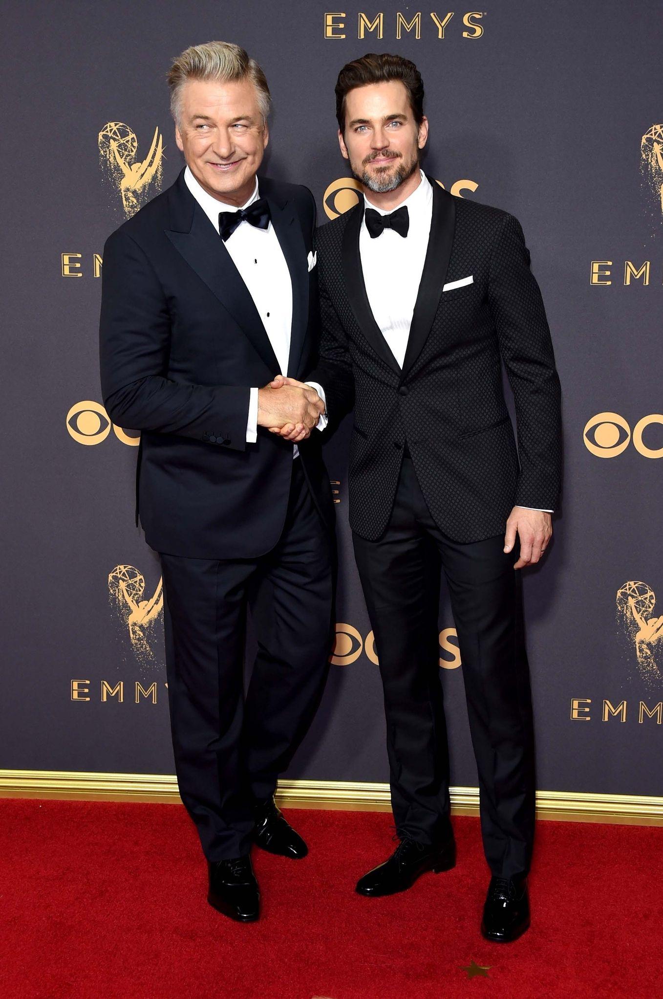 ALEC BALDWIN AND MATT BOMER In Ermenegildo Zegna Made to Measure (Baldwin) and Giorgio Armani (Bomer) at the Emmys